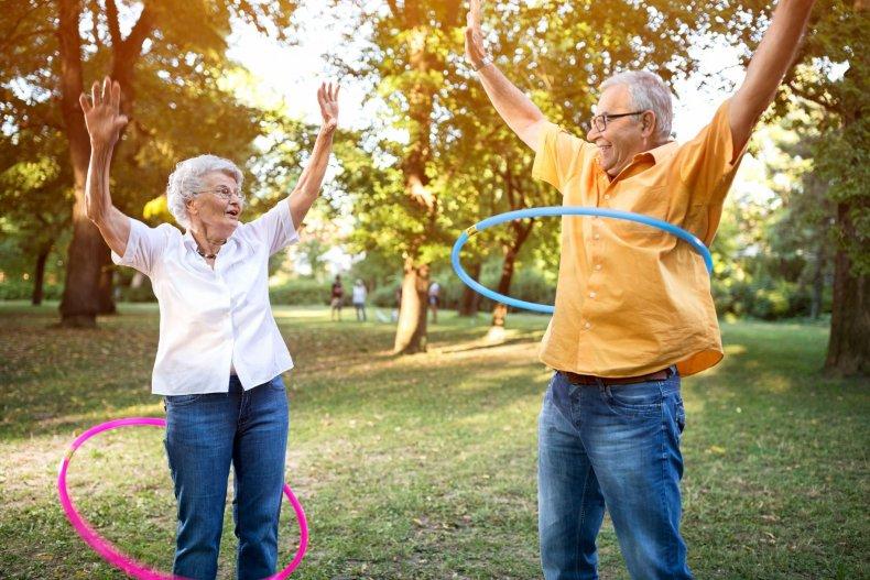 old-people-fun-hoola-hoop-stock