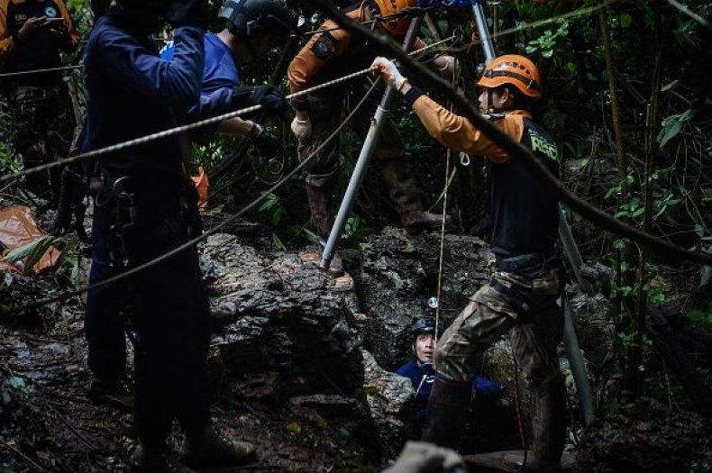 Rescuers Search a Possible Entrance