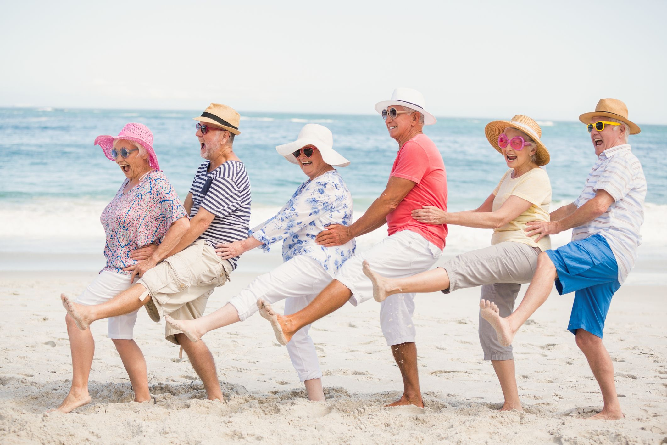 old-people-conga-dance-beach-stock