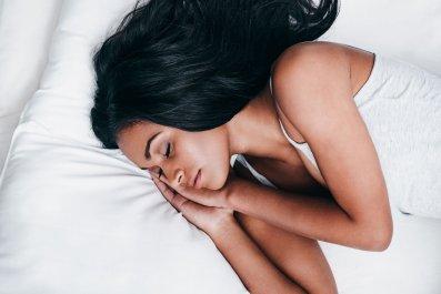 sleep-woman-bed-stock