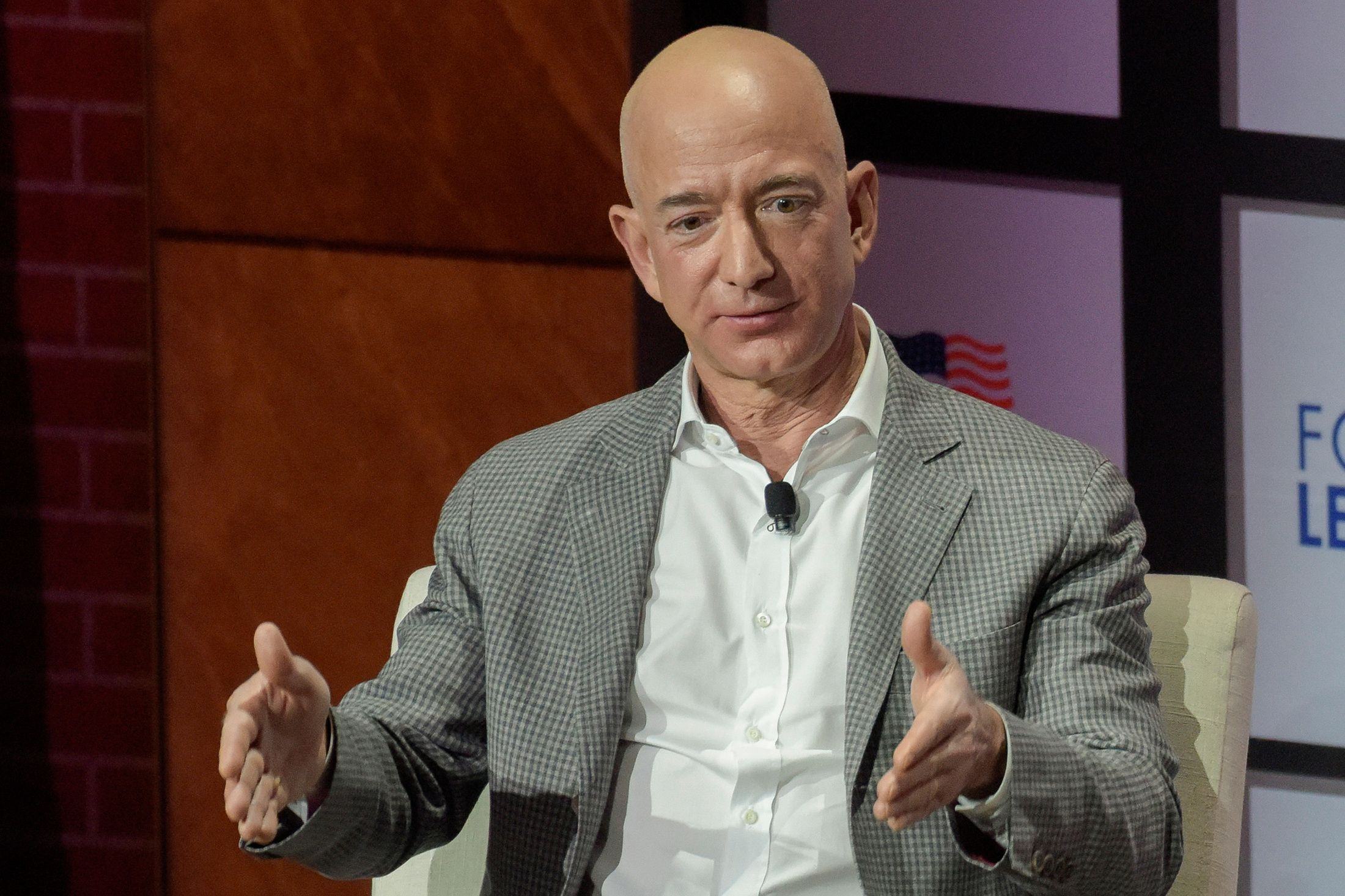 Jeff Bezos named richest man in history as Amazon workers strike over conditions