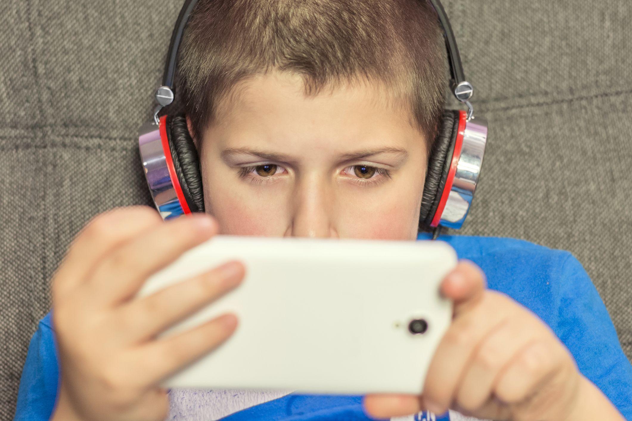 child-boy-teen-smartphone-social-media-stock