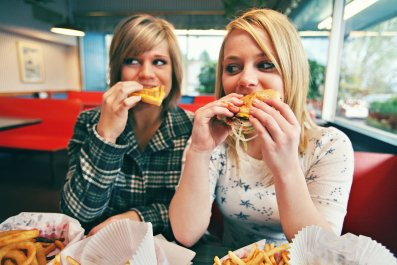 teenagers-burgers-fast-food-stock