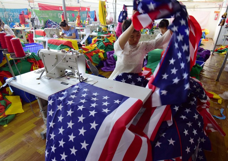 Chinese employee sewing a US flag at a factory in Fuyang