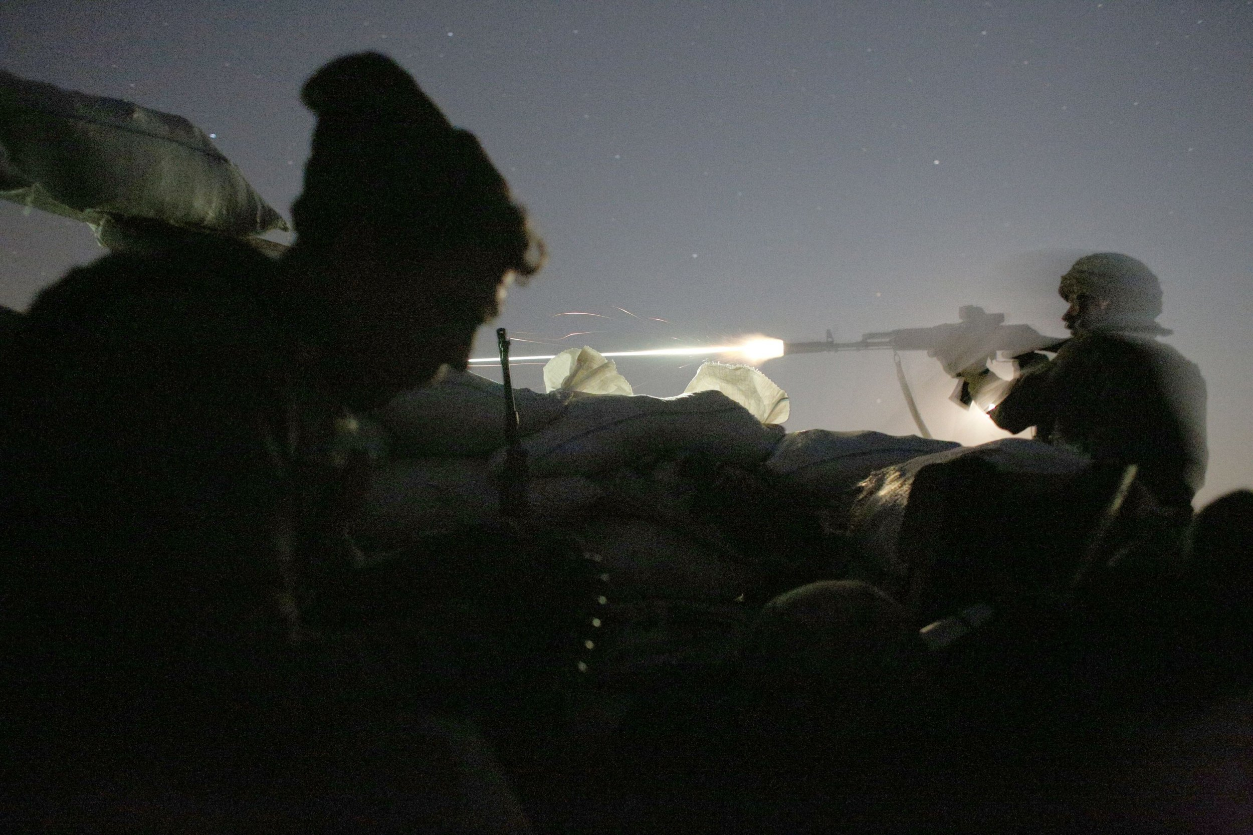 f14790d6d3d98 A Ukrainian serviceman fires his gun in the direction of Russia-backed  separatists during night combat near the village Zaytseve not far from the  the ...