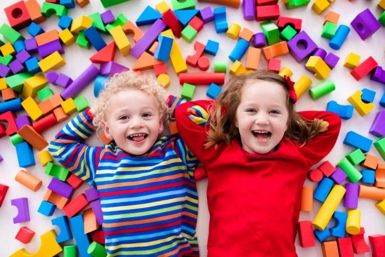 children-toys-siblings-kids-stock