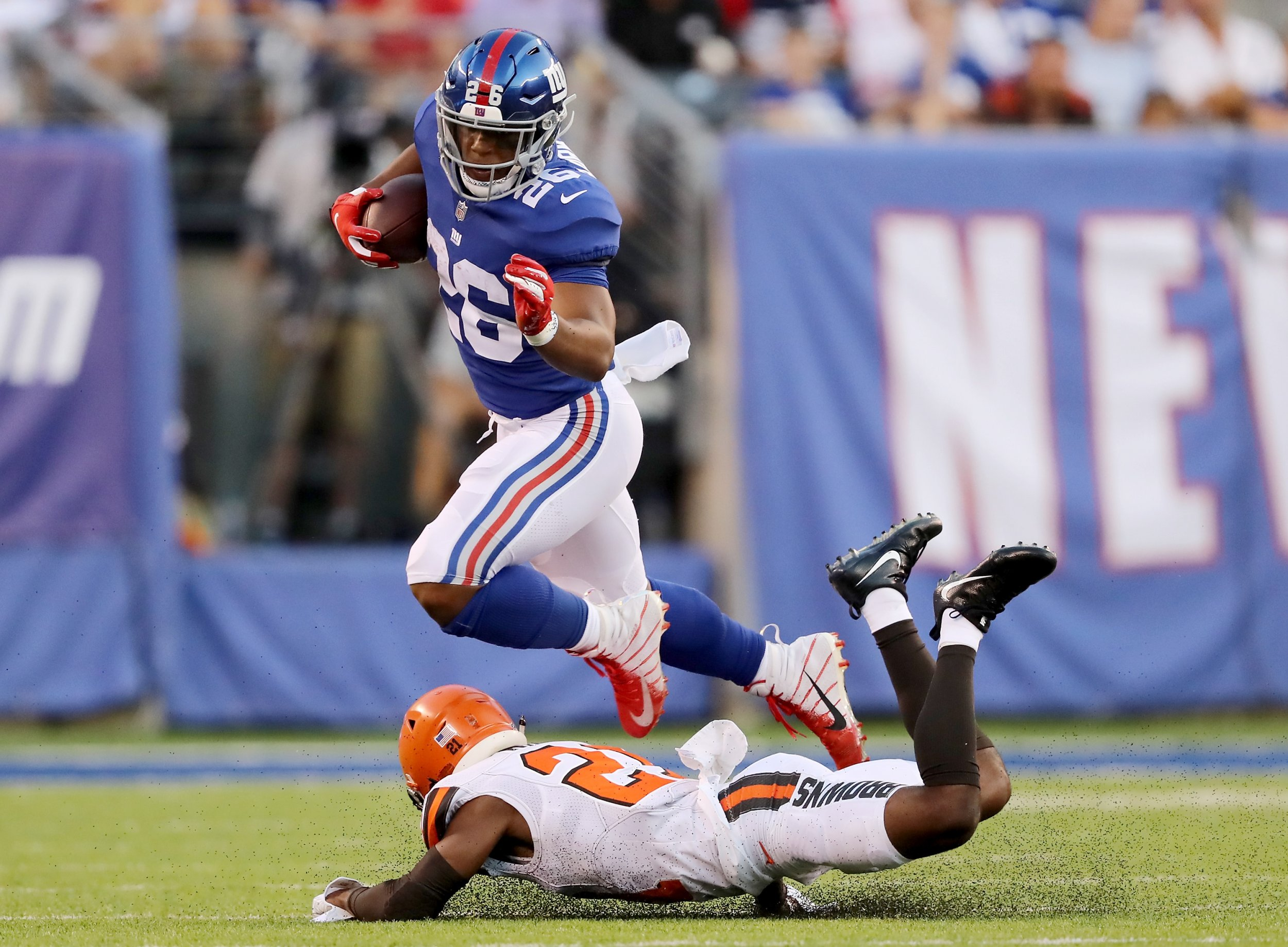 025d21c776a Saquon Barkley  26 of the New York Giants carries the ball as Damarious  Randall  23 of the Cleveland Browns defends in the first quarter during  their ...