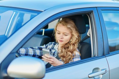 teenager-driving-texting-cellphone-stock