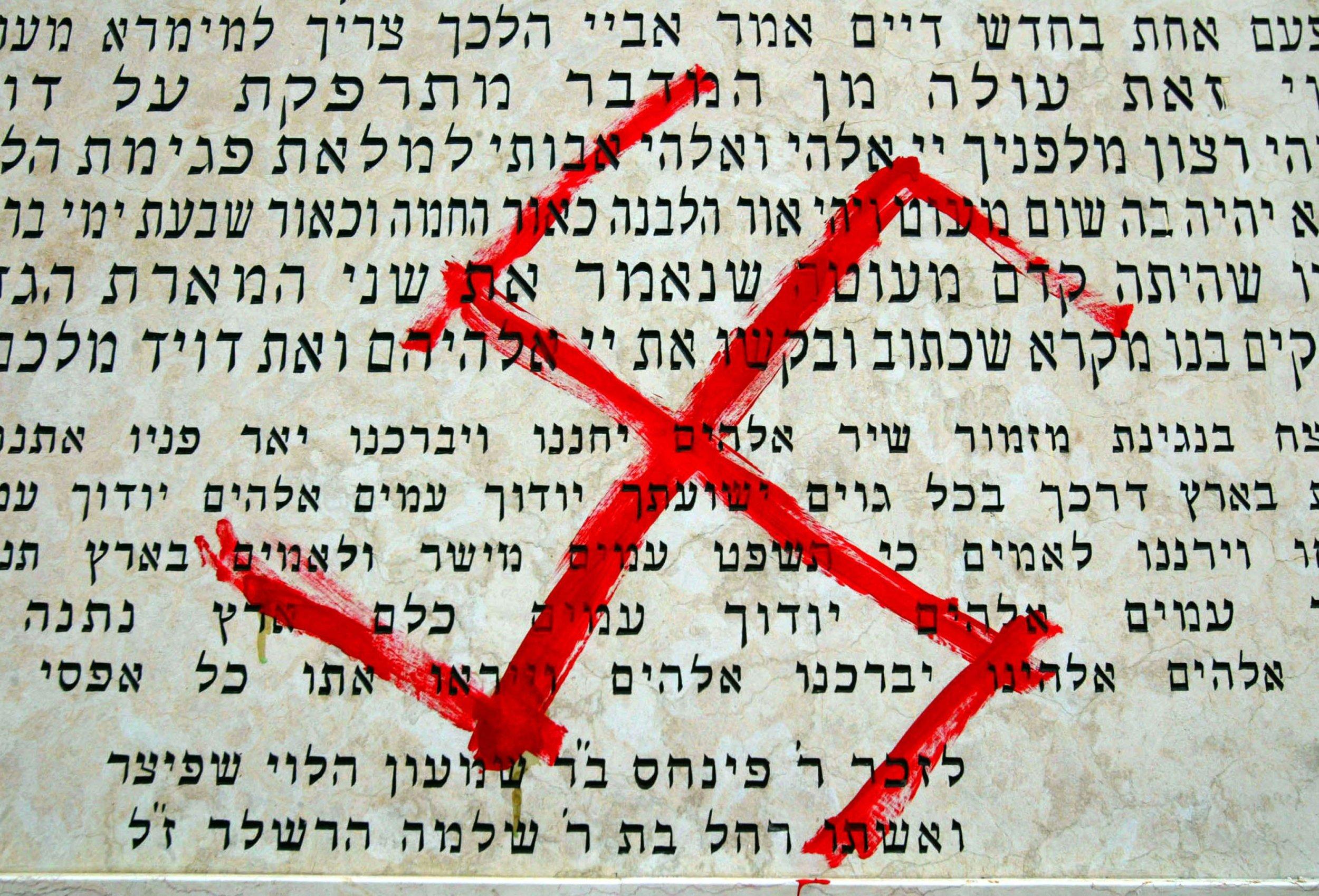 swastika federal crime charged synagogue