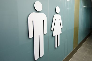man-woman-bathroom-stock
