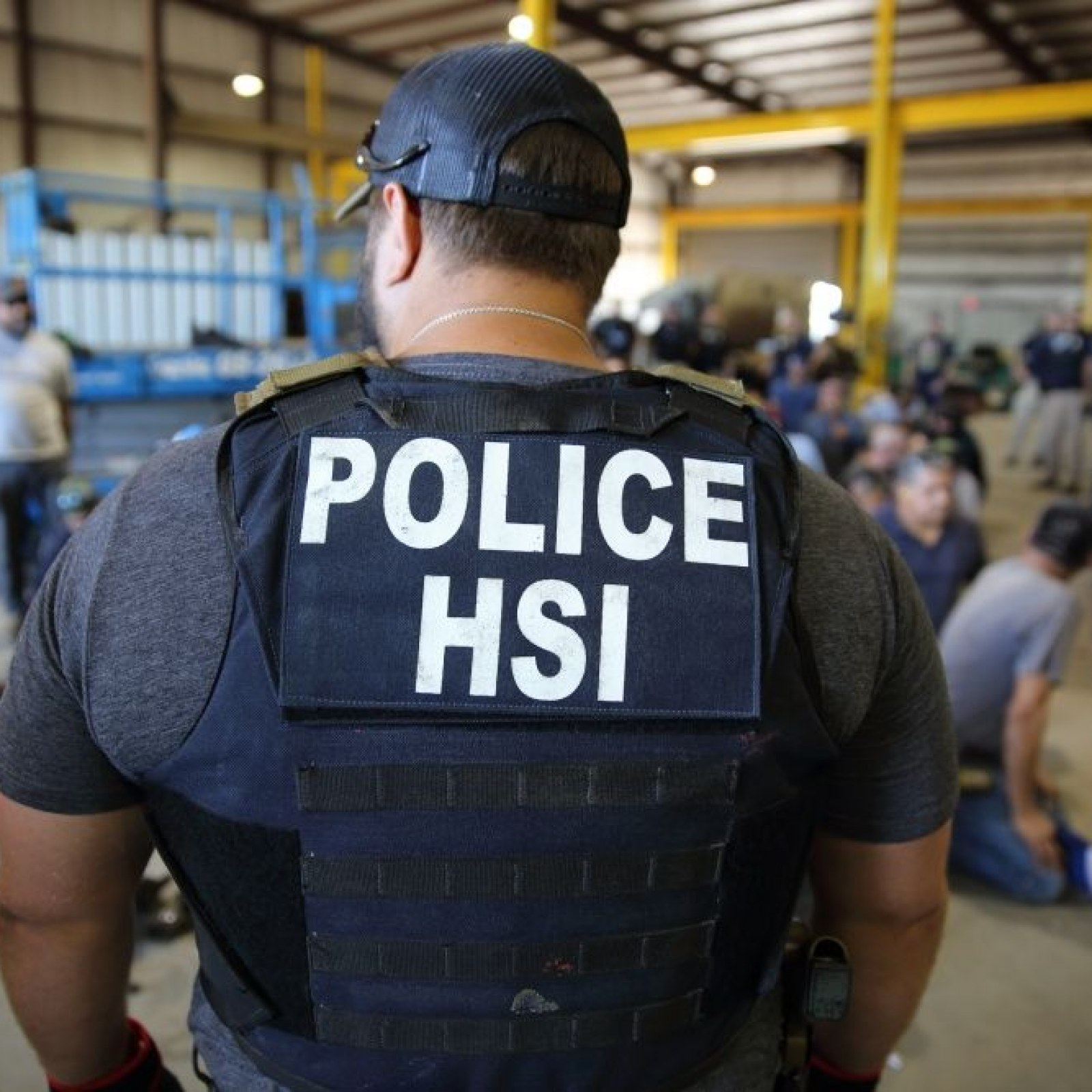 ICE Makes Mass Arrest In Family Business Raid: 'We're Watching And