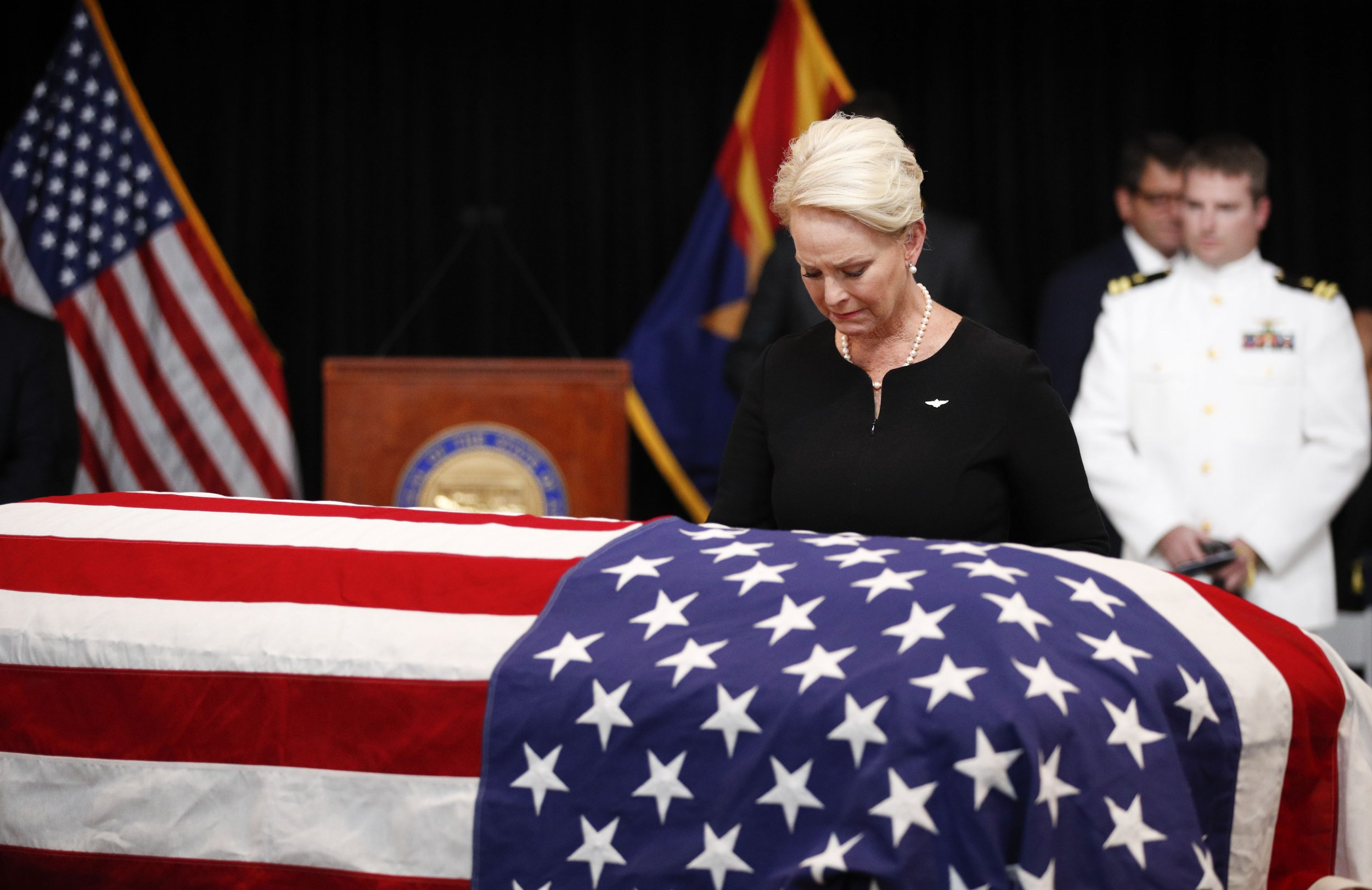 GOP, Democrats Continue Attack Ads in Arizona Despite McCain Memorial Service