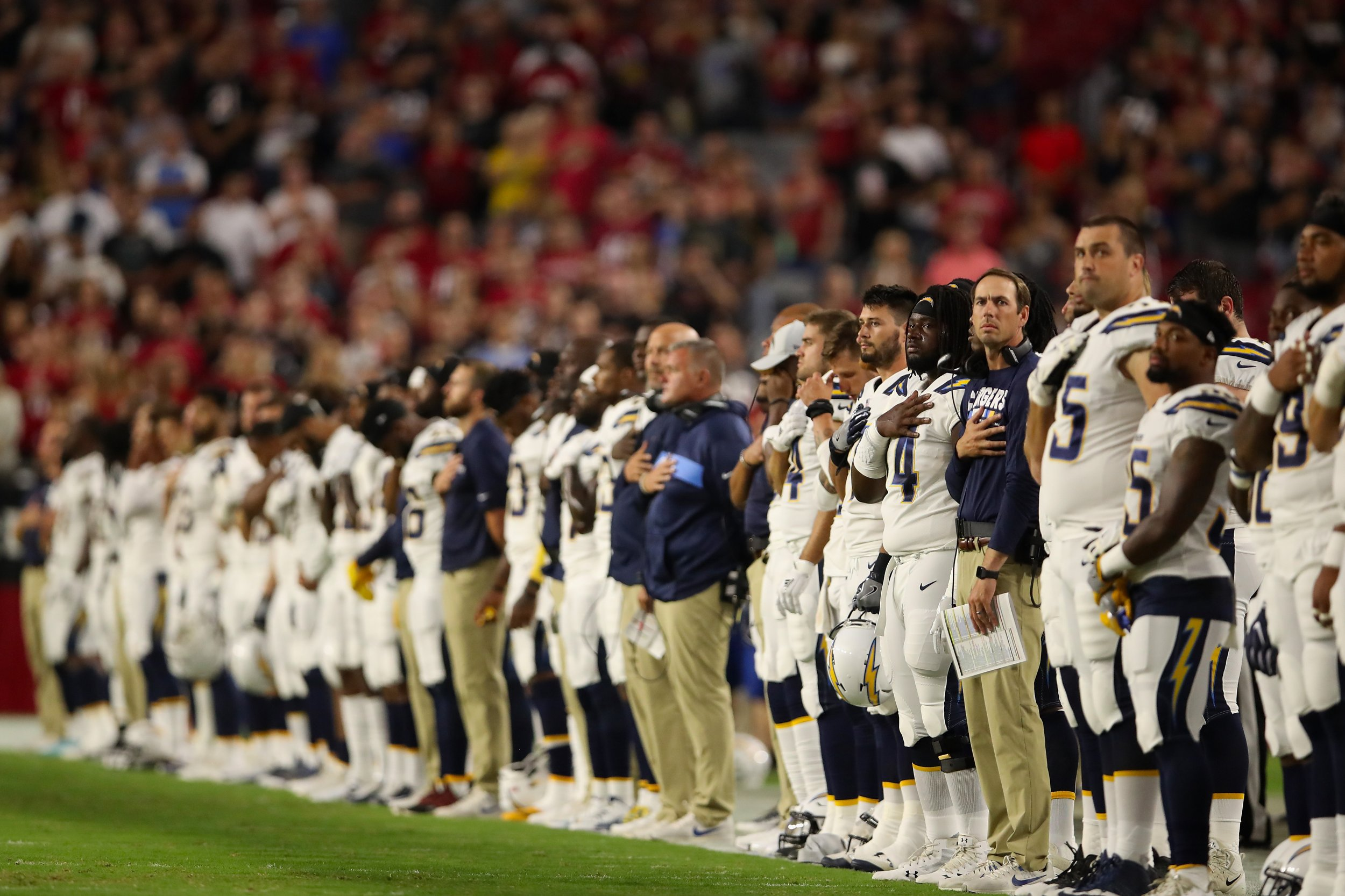 a6a87260b29 GettyImages-1015364278 The Los Angeles Chargers stand attended for the national  anthem before the preseason NFL game against the ...