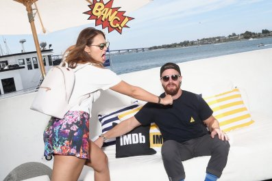 Cassandra Jean and Stephen Amell attend the #IMDboat at San Diego Comic-Con 2018.