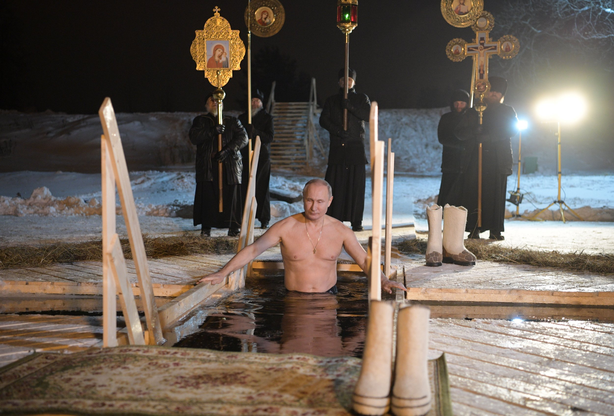 Putin's New Calendar: Topless With Fish, Bathing With
