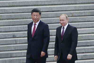 china threat U.S., Russia, FBI Director Chris Wray