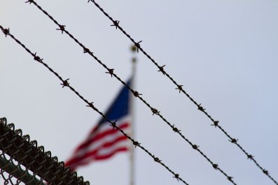 American Flag Behind Barb Wire