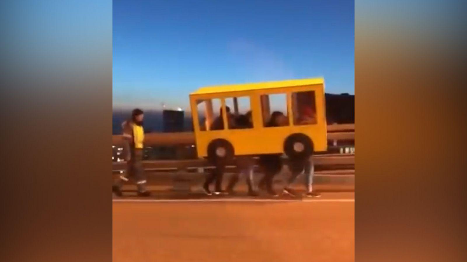 russians-caught-trying-cross-bridge-cardboard-bus