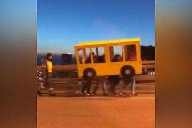 russians-caught-trying-cross-bridge-cardboard-bus