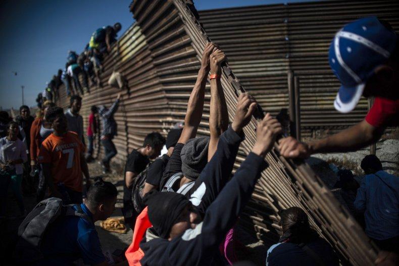migrant caravan trump wall