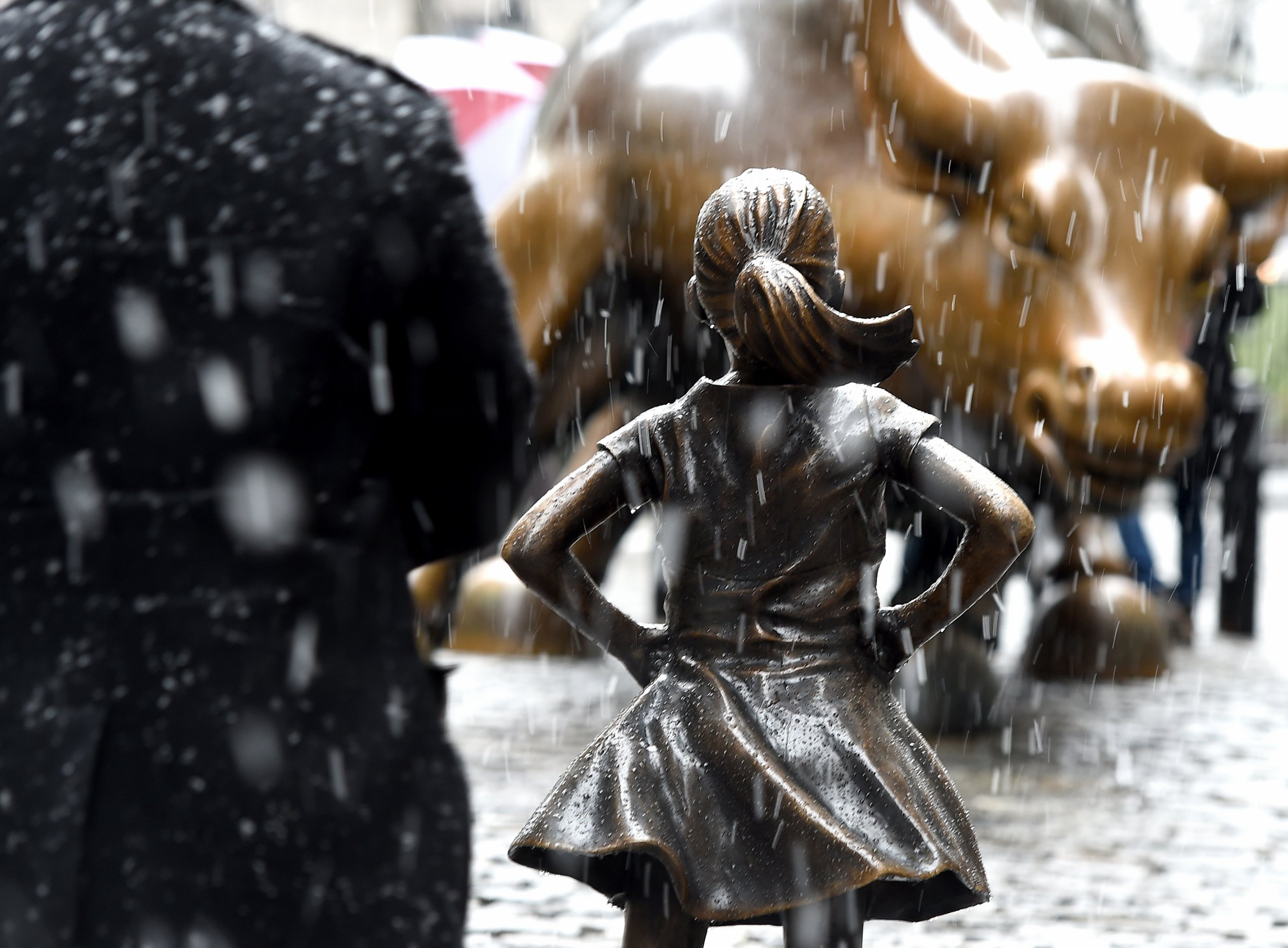 fearless girl� iconic statue moves from facing down bull