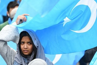 Uighurs protest human rights China European Union