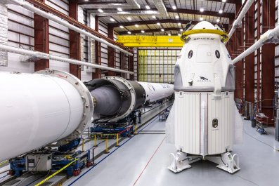 spacex dragon crew in hangar