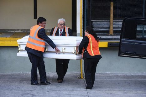 guatemala migrant child coffin carried funeral employees