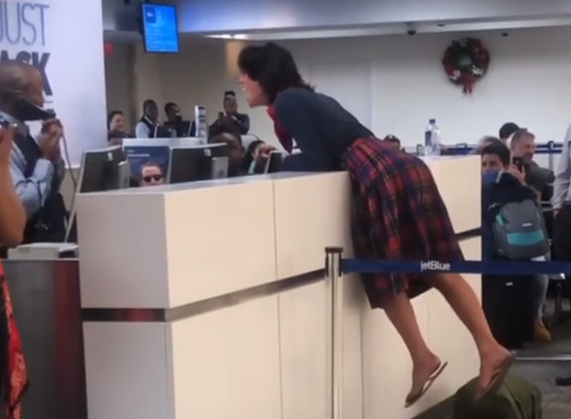 Woman Hops on Counter, Yells 'Racist' at JetBlue Employee