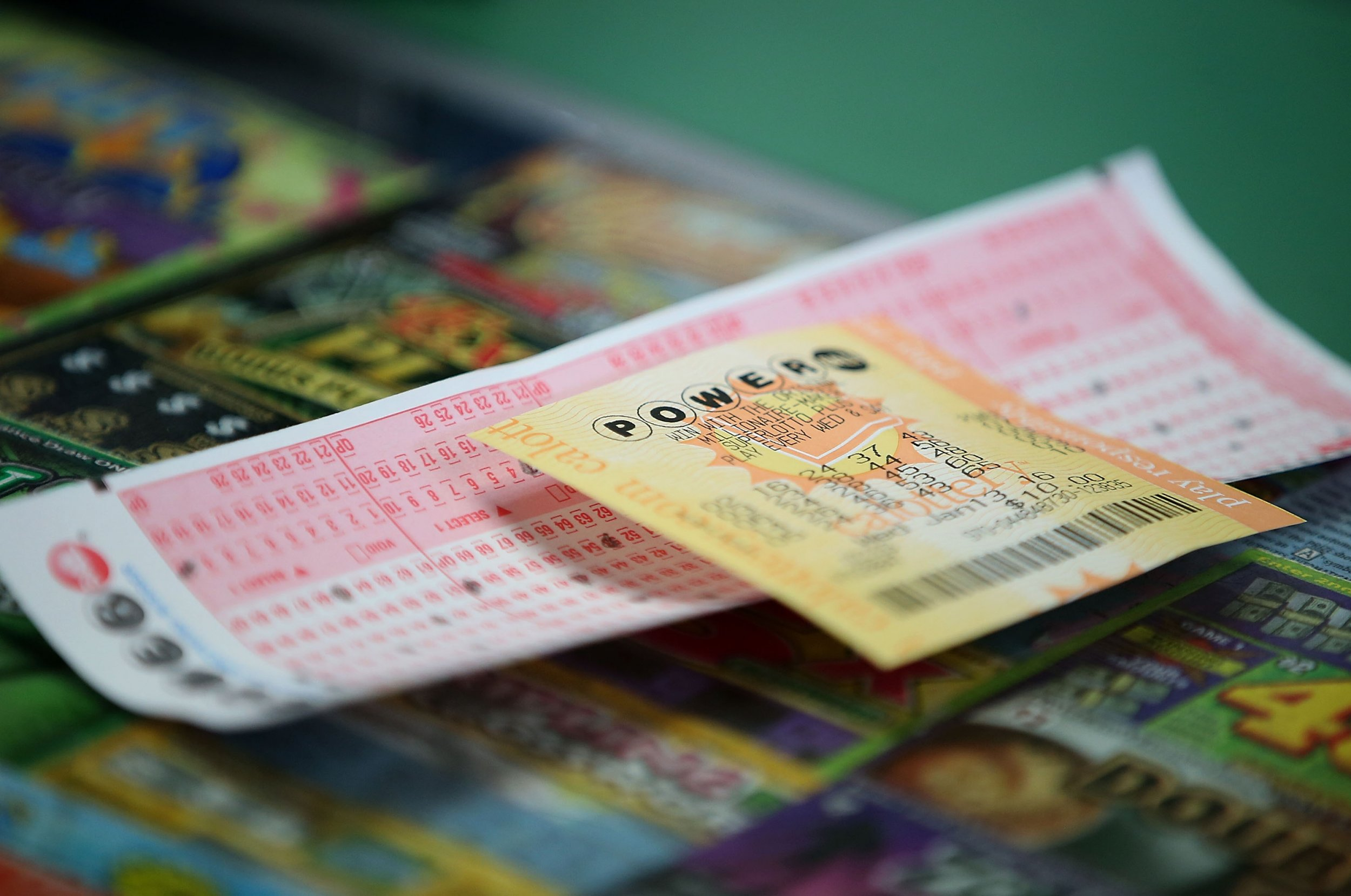powerball tickets on counter with card