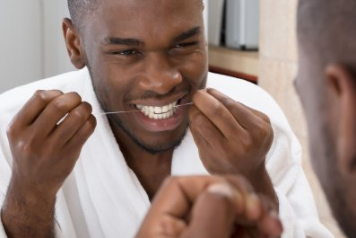 floss teeth getty stock