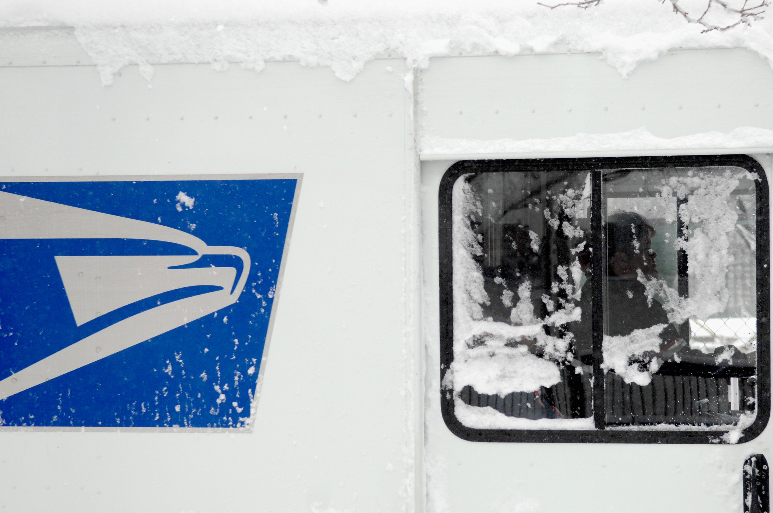 cold usps truck with snow