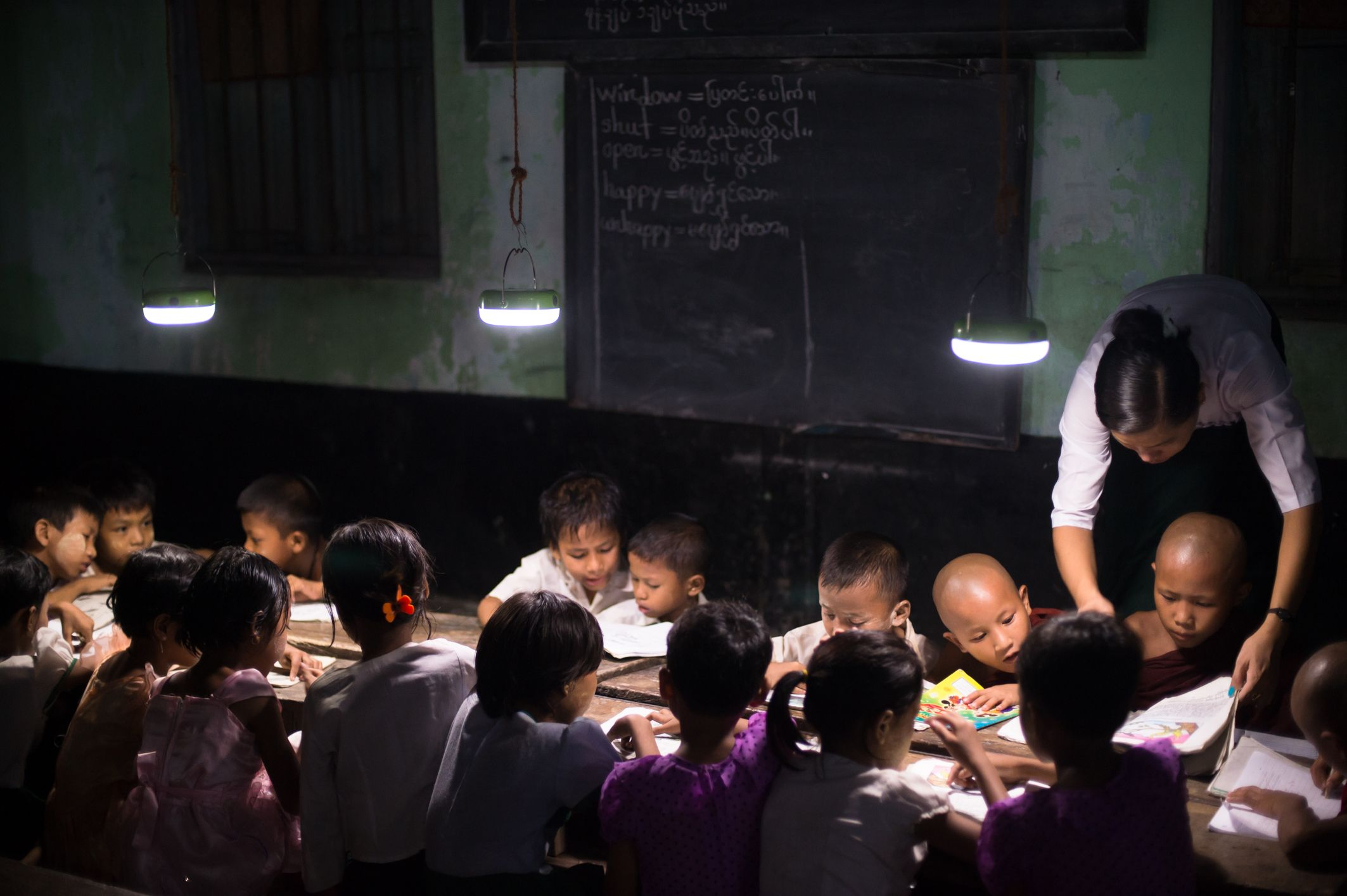 Three new solar lanterns hanged from the ceiling provided enough light to study