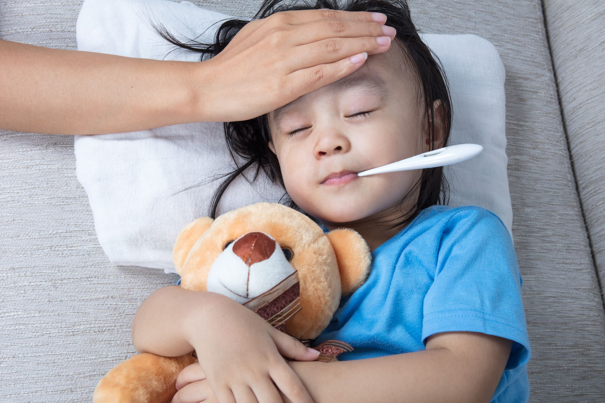 child asian sick ill getty stock