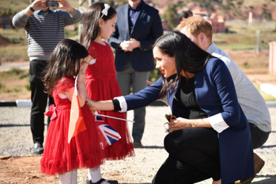 Pictures of Pregnant Meghan Markle and Prince Harry Greeting Children in Morocco and More Photos of Couple's Trip