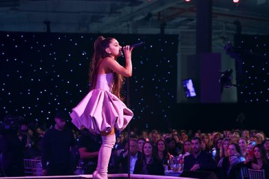 ariana grande on stage purple cloud dress