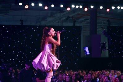 ariana grande on stage purple cloud dress