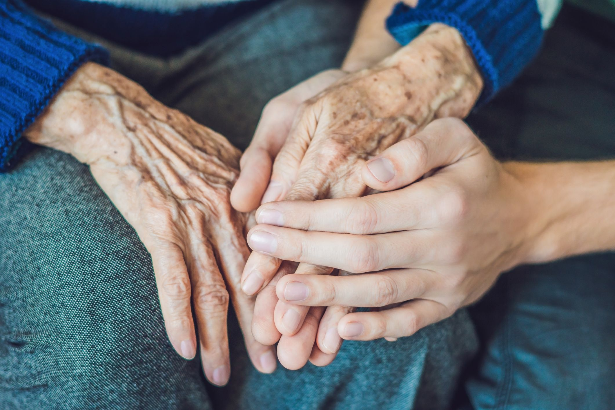 old young holding hands stock getty