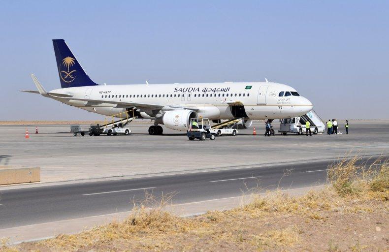 Saudi woman airport baby turn around