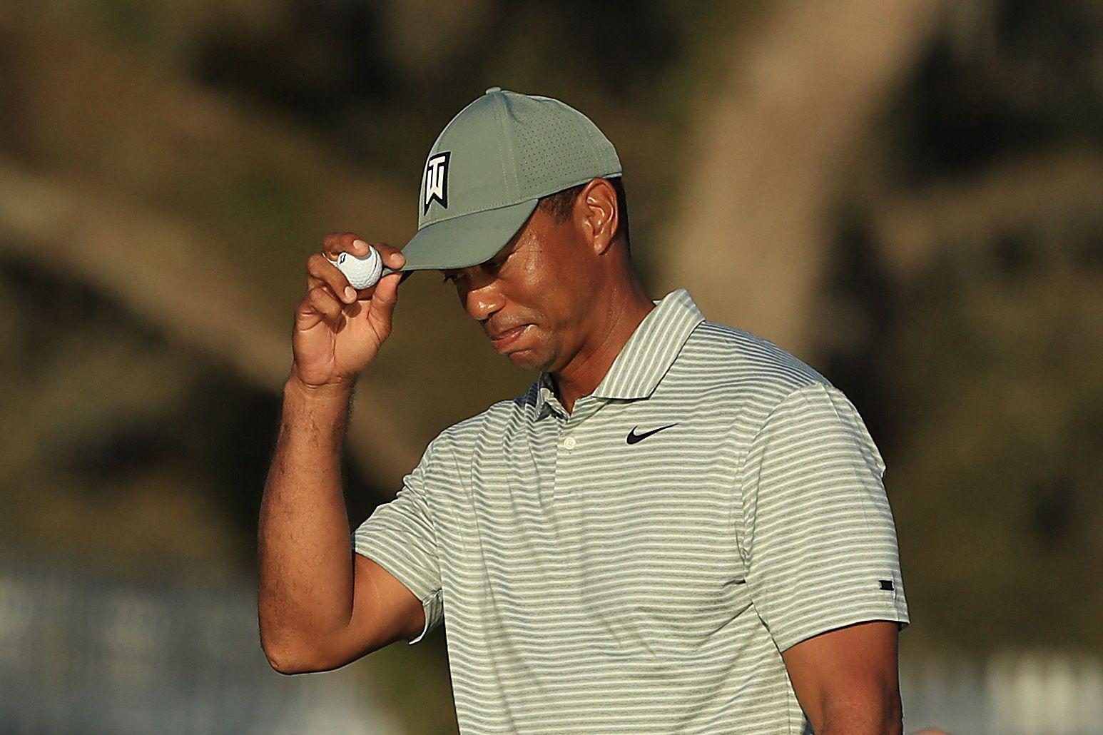 what time does tiger woods tee off on friday  the players