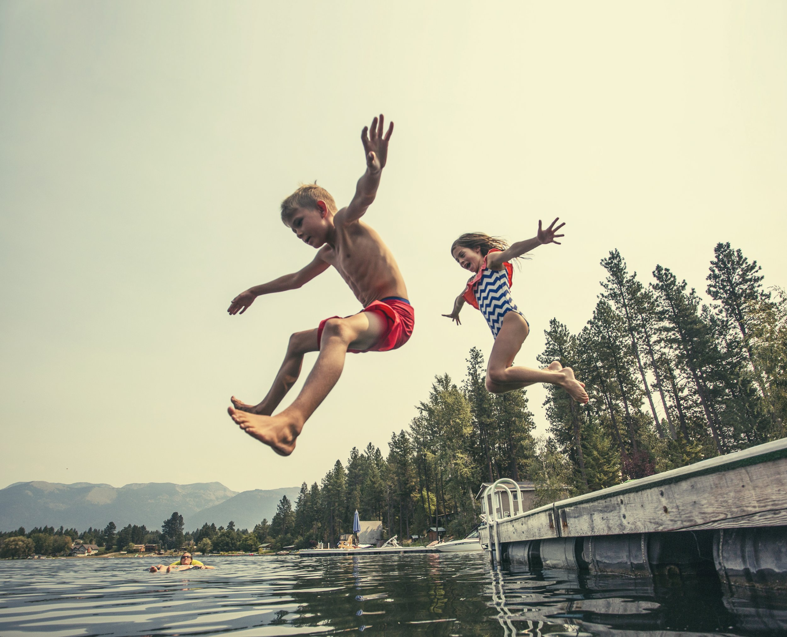 children water swim jump getty stock
