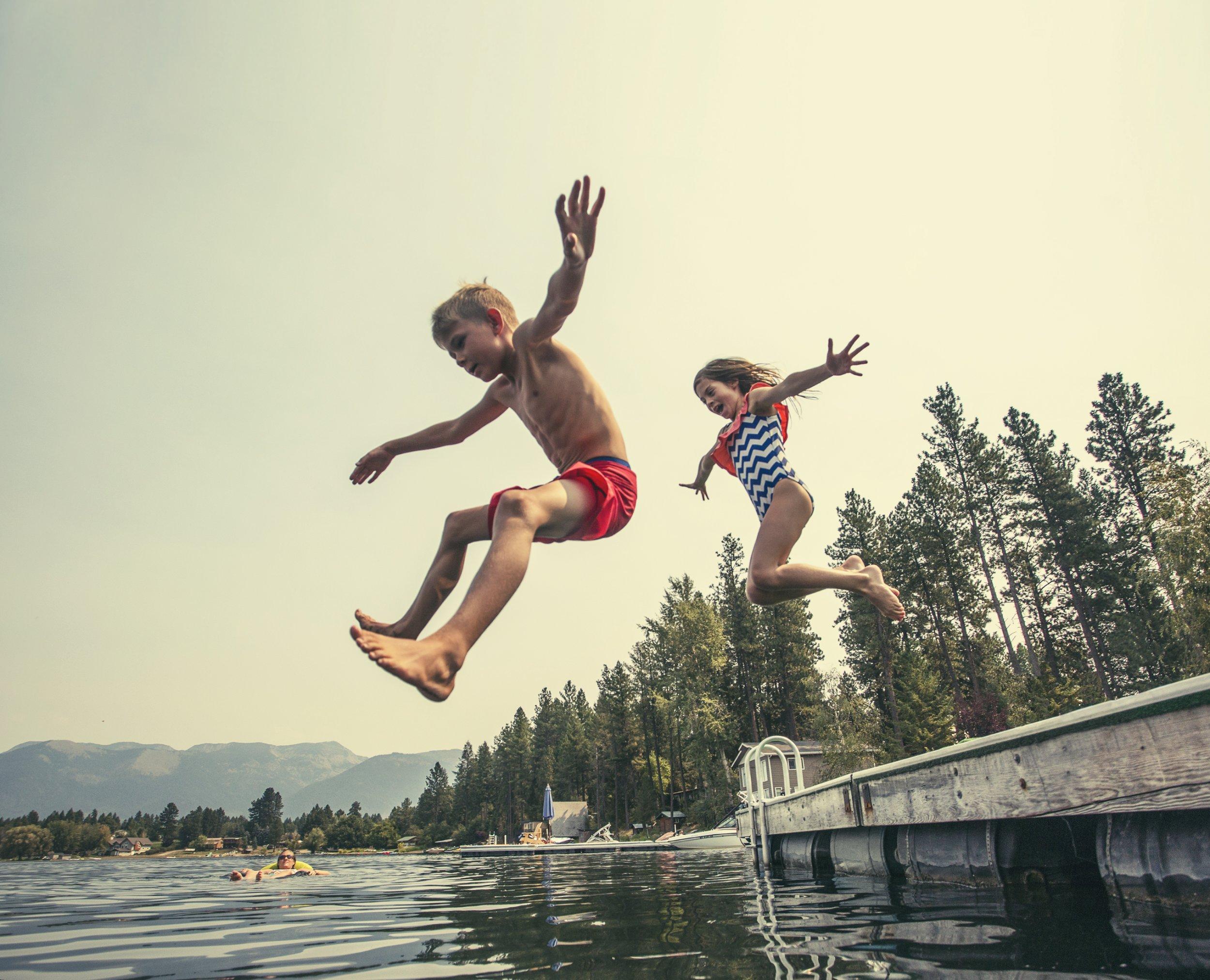 children water swim jump getty stock