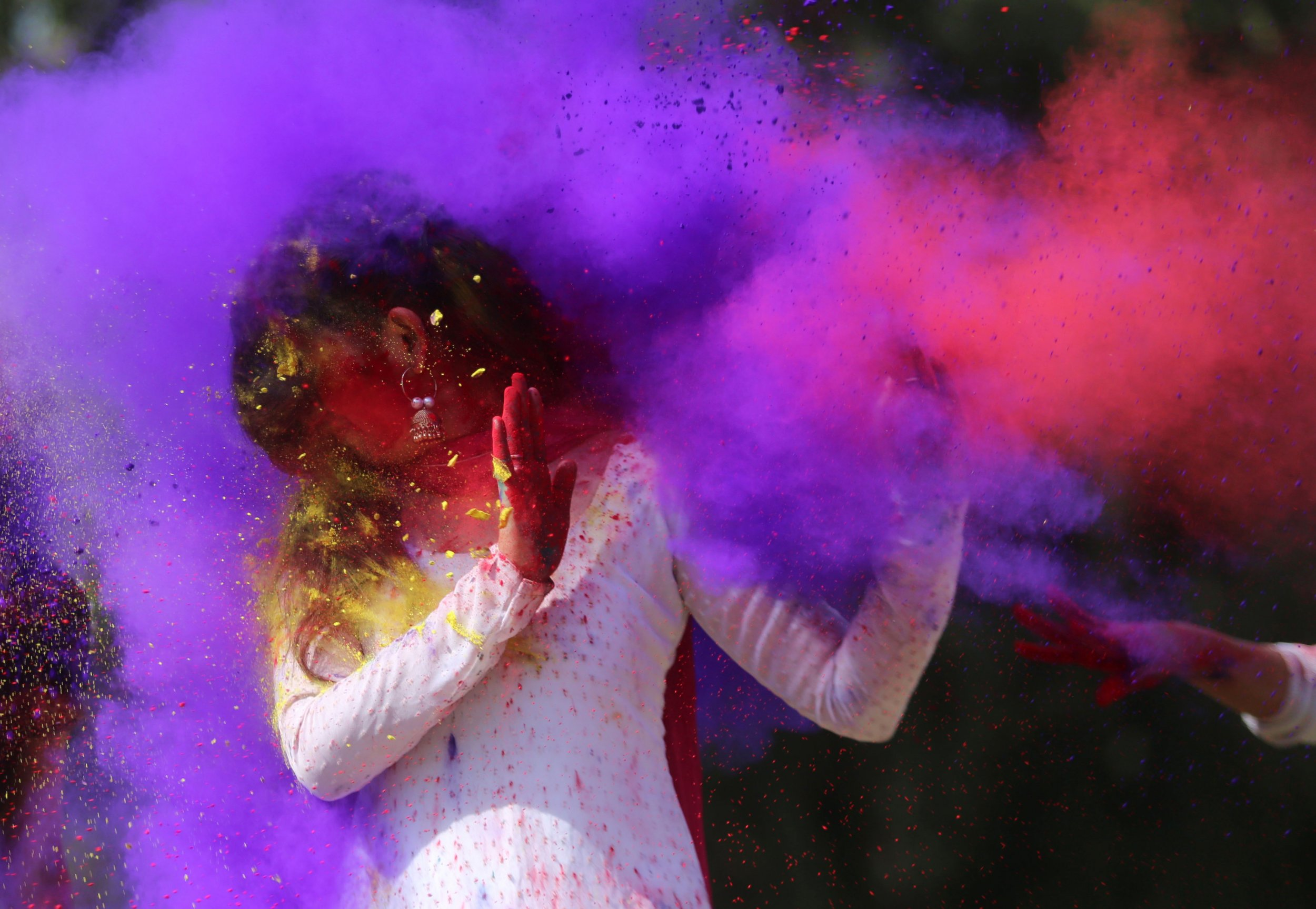 221d8bbad Indian college students throw coloured powder to one another during Holi  festival celebrations in Bhopal on February 28