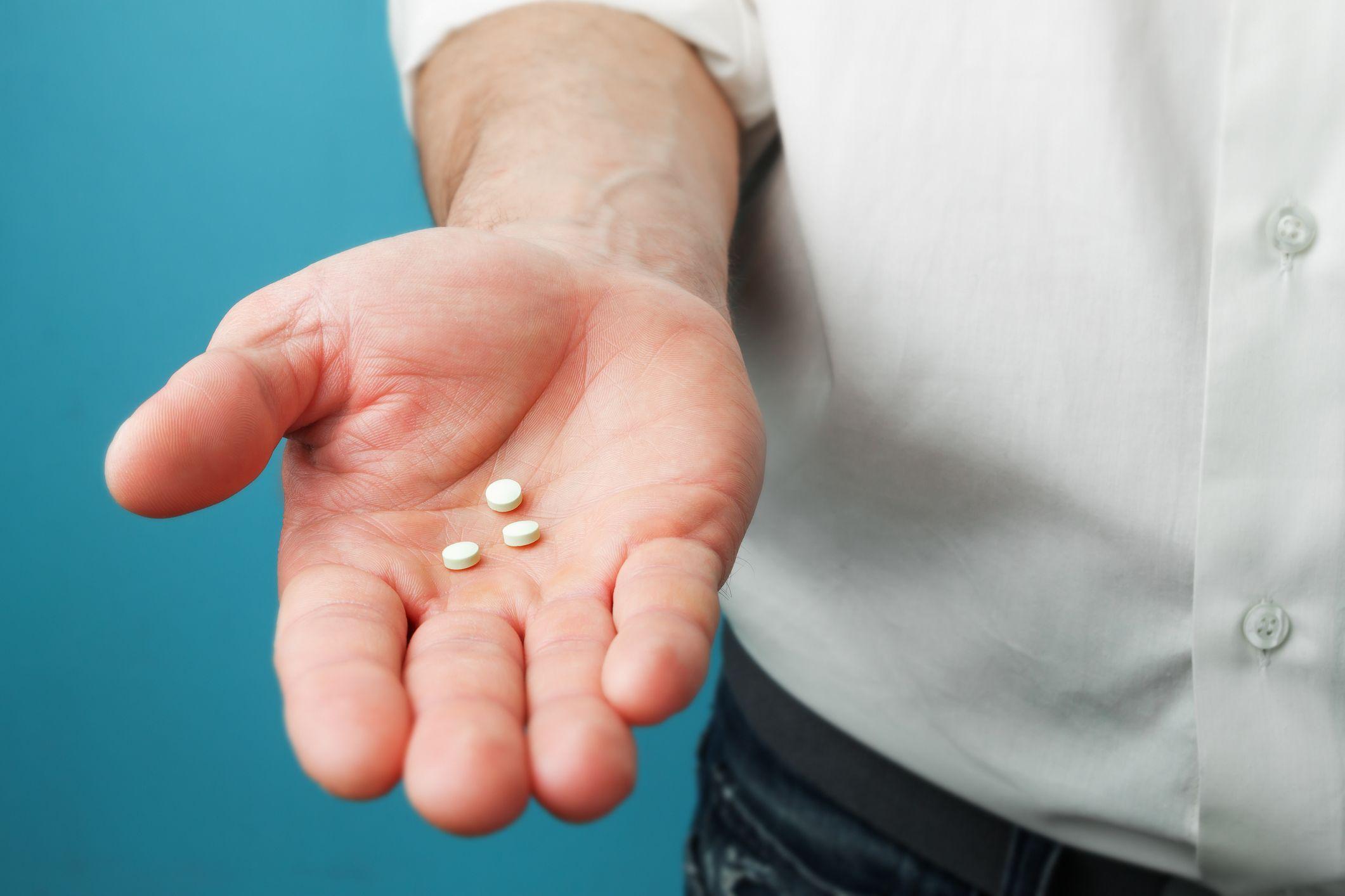 man pill drugs hand pills stock getty