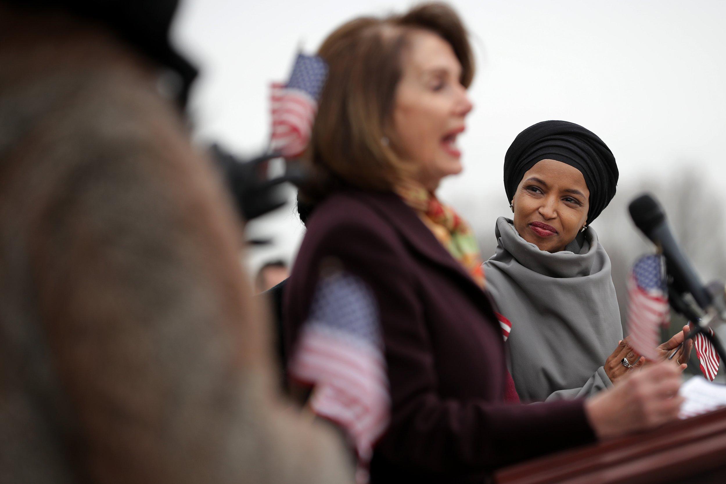 Ilhan Omar, claps, back, Nancy Pelosi