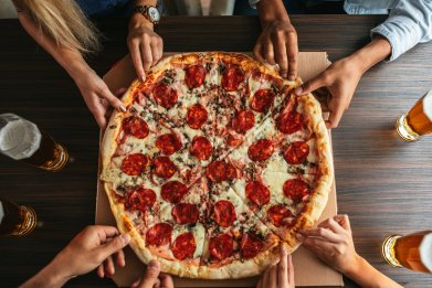 pizza eating eat food junk pepperoni stock getty
