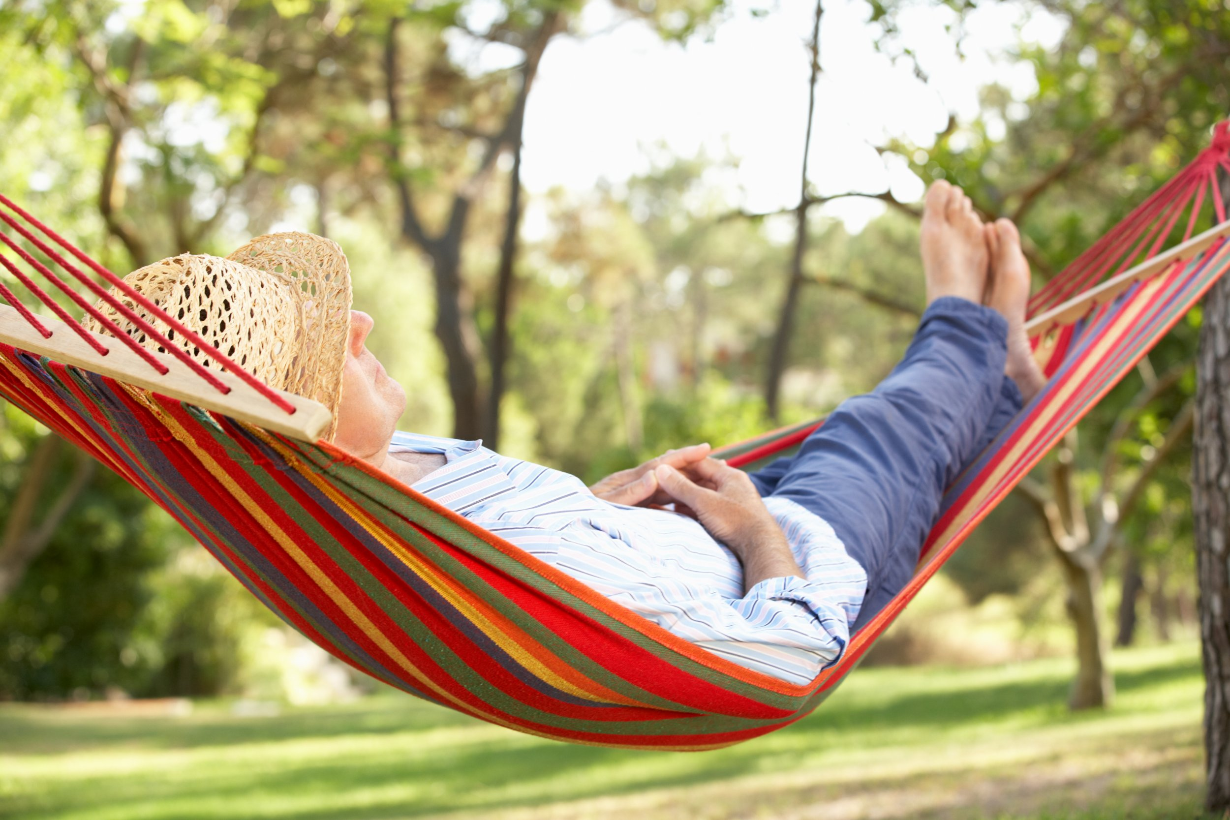 hammock man relax happy happiness content getty stock