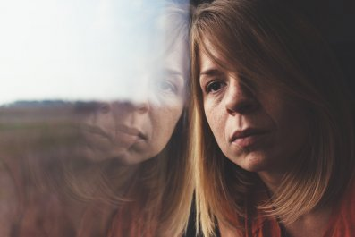 sad depression woman mental illness think thought stock getty