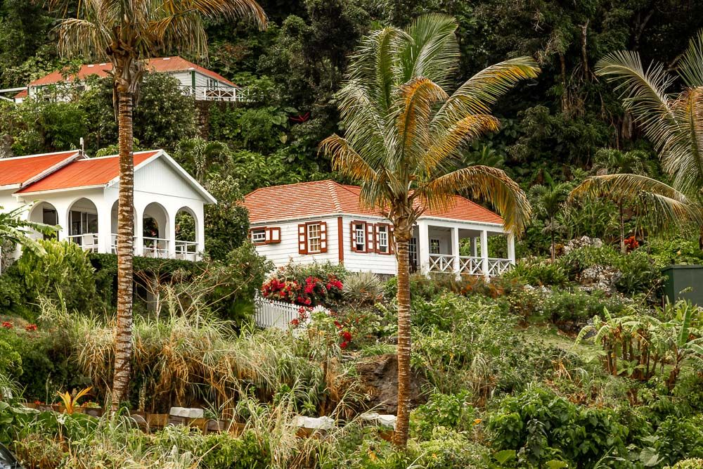 """2.A modern home next to a classic """"Saban"""" cottage in Windwardside."""
