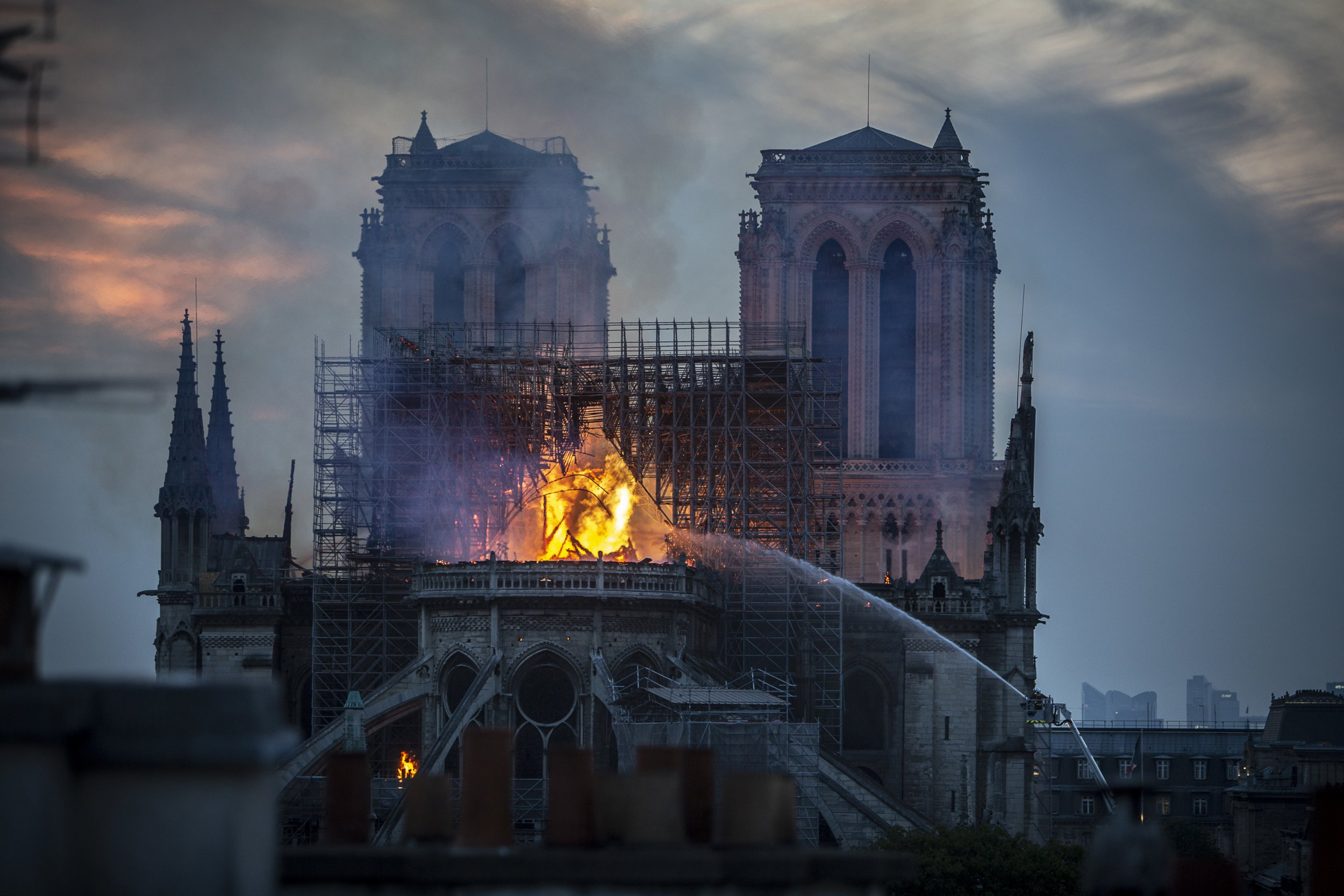 Watch the moment when Notre Dame's burning spire topples over